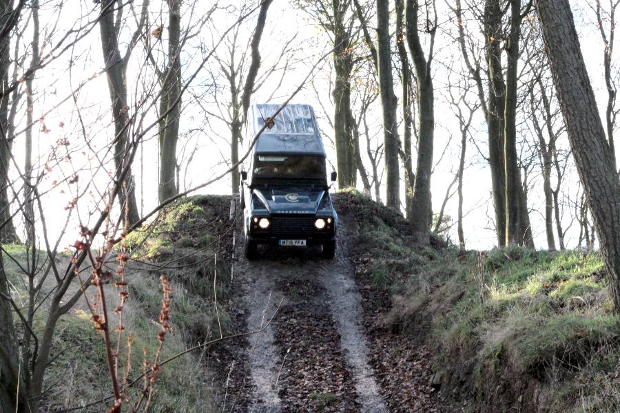 Heading down the Ski Slope in a Defender