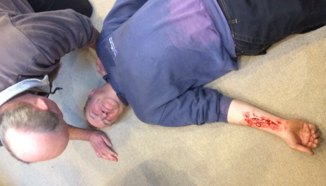 Unconscious man with open wound